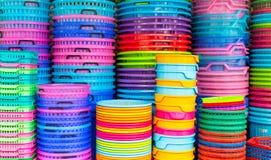 Färgrika återanvända plast-hinkar Fotografering för Bildbyråer