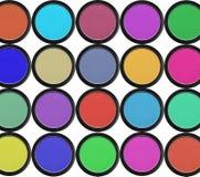 Färgrika ögonskuggor i svarta askar som isoleras på vit Arkivbilder