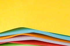 Färgrika ark av färgpapper, abstrakt bakgrund Royaltyfri Foto
