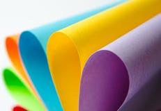 Färgrika ark av färgpapper, abstrakt bakgrund Arkivfoto