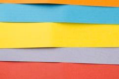 Färgrika ark av färgpapper, abstrakt bakgrund Arkivfoton