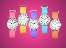 Färgrika armbandsur på fuchsiabakgrund Royaltyfri Foto