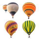 Färgrika ballonger för varm luft som isoleras på vit bakgrund Arkivfoton
