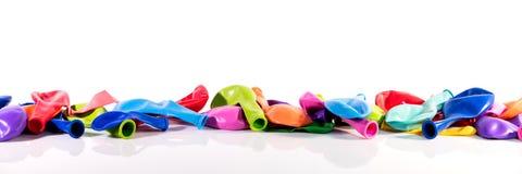 Färgrika ballonger framme av vit Royaltyfria Bilder