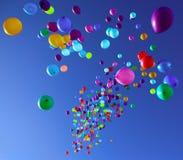 Färgrika ballonger som flyger i himmelpartiet Arkivbilder