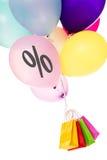 Färgrika ballons med ett procentsatstecken, shoppingpåsar Royaltyfria Foton