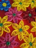 Färgrika blommor som göras av papper på orange bakgrund Royaltyfria Bilder