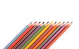 Färgrika blyertspennafärgpennor Arkivbild