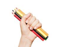 Färgrika blyertspennor i hand Royaltyfria Foton