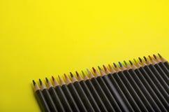 Färgrika blyertspennor med tomt utrymme för design royaltyfria bilder