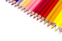 Färgrika blyertspennor stänger sig upp att vända mot ner från bästa högert hörn Fotografering för Bildbyråer