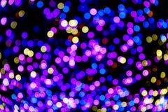 Färgrika bokehljus firar på bakgrund Royaltyfria Bilder