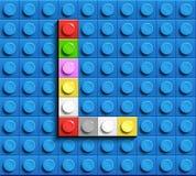 Färgrika bokstäver l av alfabetet från byggnadslegotegelstenar på blå legotegelstenbakgrund blå legobakgrund 3d märker C Realis royaltyfri illustrationer