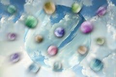 Färgrika bollar som flyttar sig för att slå den blåa stora bollen Stock Illustrationer