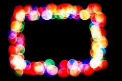 Färgrika cirklar bildar en ram bokehcirkel som isoleras på svart bakgrund Ram av cirklar royaltyfri foto