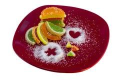 Färgrika citrusa marmeladgodisar, isolat Arkivbild