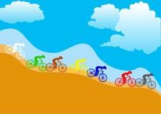 Färgrika cyklister Arkivfoton