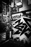 Färgrika designer i grafittigränden, Baltimore, Maryland Royaltyfri Foto