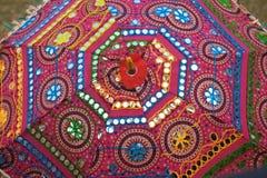 Färgrika etniska paraplyer med garneringar Royaltyfria Bilder