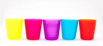Färgrika exponeringsglas eller kopp för barn Royaltyfria Bilder