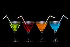färgrika exponeringsglas martini för coctailar Royaltyfria Bilder
