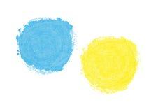 färgrika fläckar Slösa och gulna fläcken som målas med en borste Royaltyfri Bild
