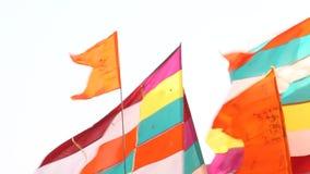 Färgrika flaggor i templet Arkivbild