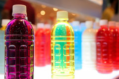 Färgrika flaskor Fotografering för Bildbyråer