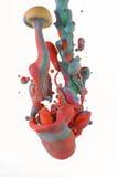 Färgrika flytande som blandar under vatten på vit bakgrund Royaltyfria Foton