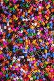 Färgrika Fusible pärlor arkivfoto