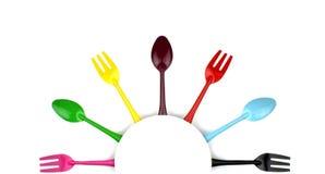 Färgrika gafflar och skedar Royaltyfria Bilder