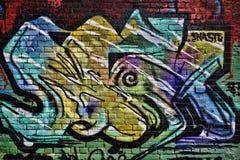 Färgrika gatagrafitti Arkivbild