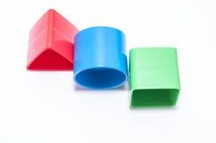 Färgrika geometriska kvarter som isoleras på vit bakgrund Arkivfoton