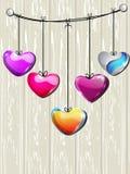 färgrika hängande hjärtaformer som sparkling Royaltyfria Foton