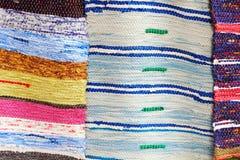 Färgrika handgjorda filtar som tas closeupen Arkivbild
