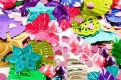 Färgrika hobbygarneringar Arkivbild