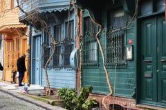 Färgrika hus och en människa Arkivbild