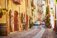 Färgrika hus på en gata av Bosa, Sardinia, Italien Fotografering för Bildbyråer