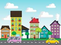 Färgrika hus på gatavektorn Royaltyfria Bilder