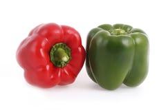 färgrika isolerade peppar för klocka Royaltyfri Bild