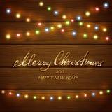 Färgrika julljus på träbakgrund royaltyfri illustrationer