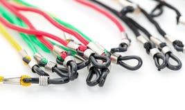 Färgrika kablar med öglor för glasögon Fotografering för Bildbyråer