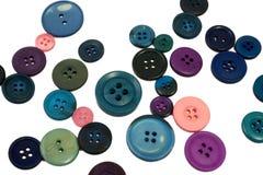 Färgrika knappar på isolerad vit Royaltyfria Foton
