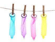 Färgrika kondomar på klädnypor Royaltyfri Fotografi