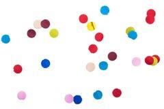 Färgrika konfettier framme på isolerad vit royaltyfri foto