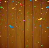 Färgrika konfettier på träbakgrund Stock Illustrationer