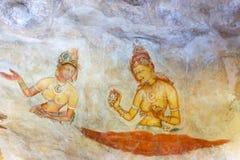 Färgrika kvinnor i grottamålning, Sigiriya, Sri Lanka Arkivfoto