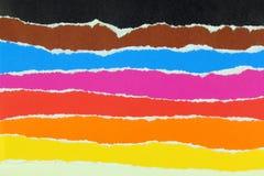 Färgrika lager av sönderrivet papper Royaltyfria Bilder
