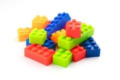 Färgrika leksakkvarter på vit bakgrund Fotografering för Bildbyråer