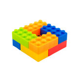 Färgrika leksakkvarter på vit bakgrund Royaltyfri Foto